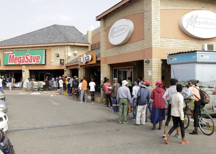 People queue outside a supermarket in Gaborone, capital of Botswana, April 2, 2020. Botswana's President Mokgweetsi Masisi has declared a state of emergency following confirmation of three coronavirus cases in that country. He has also announced a lockdown beginning on April 2 for 28 days. (Xinhua/Tshekiso Tebalo)