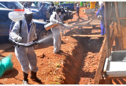 KAMPALA, April 21, 2020 (Xinhua) -- Health workers fumigate a market in Kampala, capital of Uganda, April, 17, 2020. Ugandan government on Friday started fumigating areas around city markets as well as distribution of mosquito nets to vendors sleeping in those areas. (Xinhua/Nicholas Kajoba)