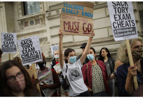 LONDON, Aug. 14, 2020 (Xinhua) -- People take part in a demonstration outside the Department of Education in London, Britain, on Aug. 14, 2020. The British government announced Wednesday a last-minute