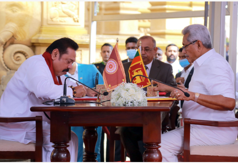 BEIJING, Aug. 10, 2020 (Xinhua) -- Leader of Sri Lanka Podujana Peramuna party Mahinda Rajapaksa (L) and Sri Lankan President Gotabaya Rajapaksa attend a ceremony at Kelaniya Temple on the outskirts of Sri Lanka's capital Colombo, Aug. 9, 2020. Mahinda Rajapaksa took his oath as the nation's new prime minister on Sunday after his party secured a landslide victory in the recently concluded parliamentary election. (Photo by Ajith Perera/Xinhua)
