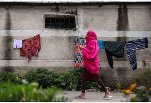 ADDIS ABABA, Aug. 15, 2020 (Xinhua) -- A woman wearing a scarf walks along an empty street in Addis Ababa, capital of Ethiopia, Aug. 14, 2020. Ethiopia's confirmed COVID-19 cases reached 27, 242 after 1,038 new COVID-19 positive cases were confirmed on Friday, the country's Ministry of Health said. (Xinhua/Michael Tewelde)