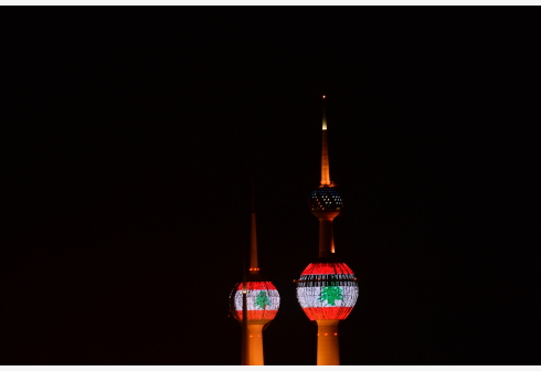 Kuwaiti Towers are illuminated with the Lebanese flag to show solidarity with Lebanon after massive explosions rocked Beirut, in Kuwait City, Kuwait, on Aug. 5, 2020. (Photo by Asad/Xinhua)