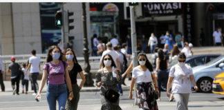 People wearing masks walk on the street in Ankara, Turkey, on Aug. 7, 2020. Turkey reported 1,185 new COVID-19 cases on Friday, raising the total diagnosed cases to 238,450, Turkish Health Minister Fahrettin Koca said. (Photo by Mustafa Kaya/Xinhua)