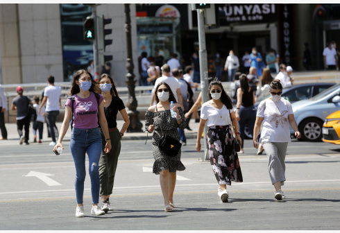 People wearing masks walk on the street in Ankara, Turkey, on Aug. 7, 2020. Turkey reported 1,185 new COVID-19 cases on Friday, raising the total diagnosed cases to 238,450, Turkish Health Minister Fahrettin Koca said. (Photo by Mustafa Kaya/Xinhua)