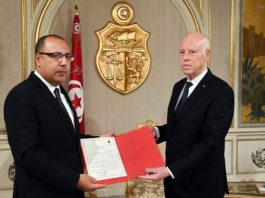 Tunisian President Kais Saied (R) assigns the current interior minister Hichem Mechichi to form a new government, in Tunis, Tunisia, July 25, 2020. (Tunisian Presidency/Handout via Xinhua)