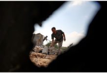 A Palestinian man inspects the damages of a house following an Israeli airstrike east of al-Bureij refugee camp in central Gaza Strip, on Aug. 15, 2020. Israeli army aircraft struck on Friday night posts and facilities in the Gaza Strip that belong to Islamic Hamas movement militants in response to launching incendiary balloons from the coastal enclave into Israel. (Photo by Yasser Qudih/Xinhua)