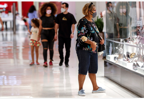 Several people walk through a shopping center, in Sao Paulo, Brazil, 11 June 2020. Sao Paulo and Rio de Janeiro, two of the most populous cities in Brazil and the most affected by the COVID-19 pandemic, reopened their shopping centers on 11 June, the same day that the country will surpass 40,000 deaths from coronavirus and despite the fact that the peak of infections has not yet arrived. EPA/Sebastiao Moreira