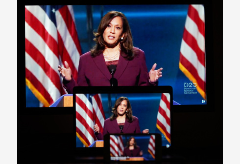 WASHINGTON, D.C., Aug. 20, 2020 (Xinhua) -- Images of U.S. Senator Kamala Harris speaking in a video feed of the 2020 Democratic National Convention are displayed on screens in Arlington, Virginia, the United States, on Aug. 19, 2020. U.S. Senator from California Kamala Harris, who was chosen by Democratic presidential candidate Joe Biden to be his running mate in the 2020 presidential election, delivered a speech Wednesday to formally accept her nomination as the party's candidate for vice president. (Xinhua/Liu Jie)