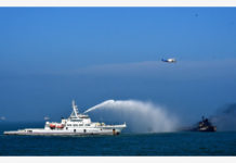 A rescue vessel tries to put out fire emerging from an oil tanker after it collided with a cargo ship near the Yangtze River estuary, Aug. 20, 2020. Three had been rescued and 14 others went missing after an oil tanker collided with a cargo ship about 1.5 nautical miles southeast of the Yangtze River estuary early Thursday, according to the maritime authorities in Shanghai. The accident occurred at 3: 39 a.m. Thursday, when an oil tanker carrying about 3,000 tonnes of gasoline collided with a cargo ship loaded with sand and gravel, causing a fire on the deck of the oil tanker and the latter to sink. (Donghai Rescue Bureau/Handout via Xinhua)