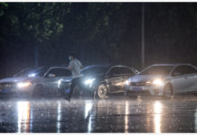 BEIJING, Aug. 12, 2020 (Xinhua) -- A man runs in rain in Daxing District, Beijing, capital of China, Aug. 12, 2020. Beijing meteorological authorities issued a yellow alert for rainstorms, forecasting that torrential rain would batter the Beijing-Tianjin-Hebei region between Wednesday and Thursday. (Xinhua/Peng Ziyang)