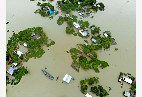 FARIDPUR, July 20, 2020 (Xinhua) -- Aerial photo shows flood-affected houses in Faridpur, Bangladesh, July 19, 2020. Floods triggered by heavy seasonal rains and onrush of water from hills have worsened again in parts of Bangladesh, including central Faridpur district, some 101 kilometers away from the capital Dhaka. (Xinhua)