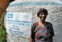 A local woman in Ghadaig Town, Amhara region, Ethiopia, takes a photo in front of a Chinese-funded water cellar. (Photo/Courtesy of XCMG)