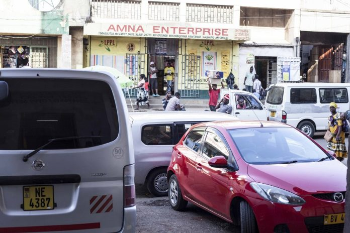 Photo taken on Sept. 24, 2020 shows a street with vehicles parked around shops after street vendors were removed in Blantyre, Malawi. Shop owners in Blantyre city have reacted differently over the city council's clean up exercise which saw street vendors being chased out of the streets. (Photo by Joseph Mizere/Xinhua) TO GO WITH Feature: Removal of street vendors in Blantyre sparks mixed reactions