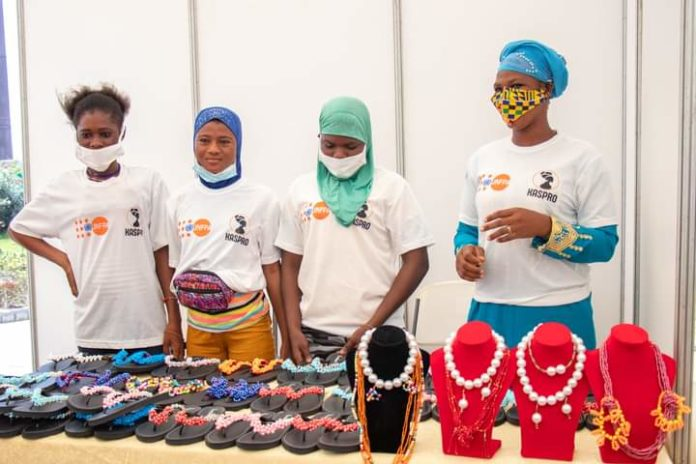 Some of the beneficiaries exhibiting their works.