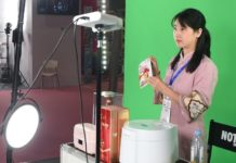 A live stream host demonstrates the products in a studio during the 2020 China Yiwu Network Broadcast and Short Video Industry Expo that kicked off in the Yiwu International Expo Center, located in Yiwu, east China's Zhejiang province, on Sept. 26. (Photo by Gong Xianming/People's Daily Online)