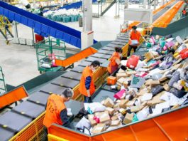 Workers sort parcels in a parcel handling center of the Nanchong branch of China Post in southwest China's Sichuan province, Nov. 10. (Photo by Li Tao/People's Daily Online)