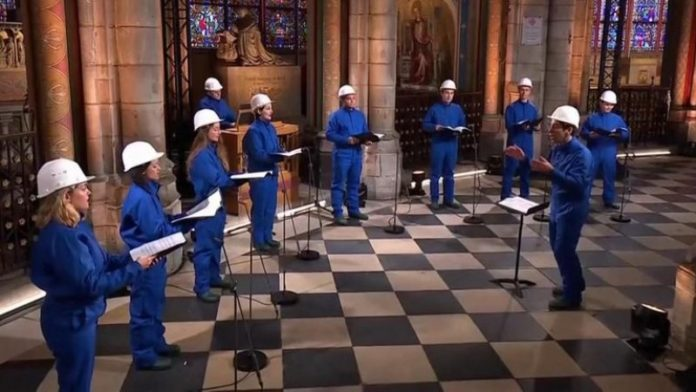 Choir performs in safety gear