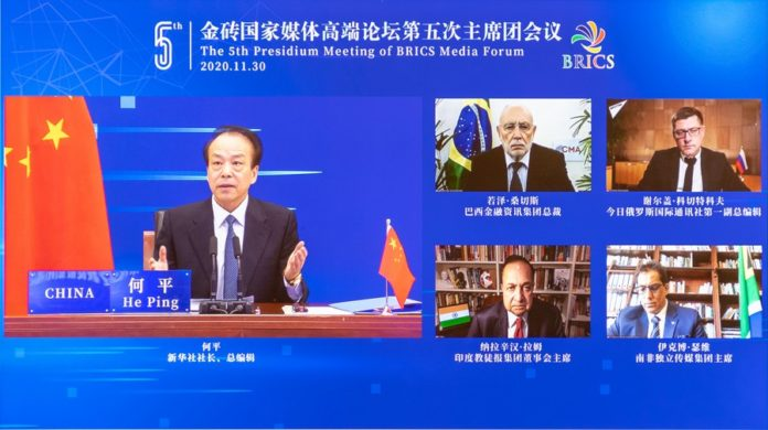 Executive chairman of the BRICS Media Forum He Ping, also president and editor-in-chief of Xinhua News Agency, presides over the fifth presidium meeting of the BRICS Media Forum in Beijing, capital of China, Nov. 30, 2020. (Xinhua/Zhai Jianlan)