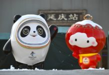 Beijing 2022 Winter Olympic and Paralympic mascots stand in front of the Yanqing station of Beijing-Zhangjiakou High-speed Railway, a key infrastructure project for the Beijing 2022 Olympic Winter Games that starts operation on Dec. 1. Photo by Sun Lijun/People's Daily Online
