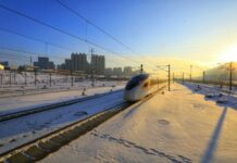 A Fuxing bullet train specifically tailored for cold regions runs on Beijing-Harbin high speed railway which is opened on Jan. 22. (Photo by Yuan Yong/People's Daily Online)