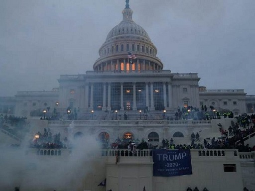 'QAnon Shaman' Jake Angeli Charged Following Capitol Riot | KFI AM 640