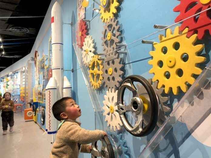 A child plays at a science and technology museum in Lu'an city, east China's Anhui province, Jan. 3, 2021. (Photo by Tian Kaiping/People's Daily Online)