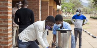 Students wash hands at school in Phalombe, Malawi, Oct. 13, 2020. The number of confirmed COVID-19 cases in the African continent has surpassed 2 million, the Africa Centers for Disease Control and Prevention (Africa CDC) said on Thursday. The latest figures from the continental disease control and prevention agency showed that a total of 2,013,388 cases were reported across the continent with the death toll related to the pandemic standing at 48,408 as of Thursday morning. (Photo by Joseph Mizere/Xinhua)