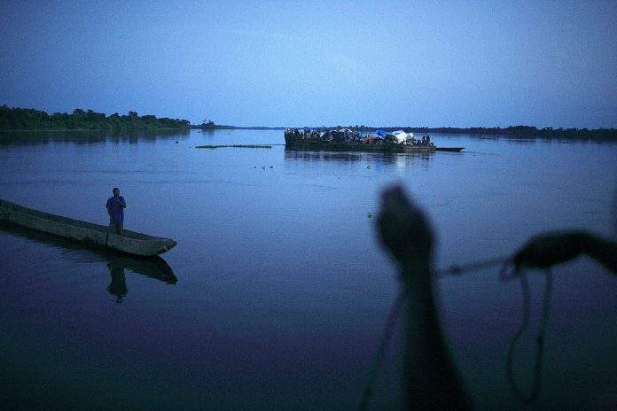 File photo: A barge with about three hundred people ran aground in the evening on the Congo River, DRC. (Photo by Per-Anders Pettersson/Exclusive by Getty Images)