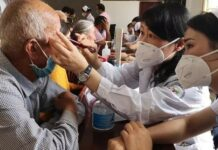 Medical workers aiding Xijiang Uygur autonomous region from east China's Zhejiang province check health conditions for villagers in Awat county, Aksu prefecture, Xinjiang Uygur autonomous region, June 18, 2020. (Photo by Zhejiang News)