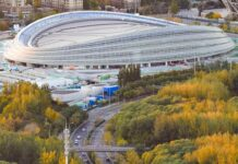 Photo taken on Oct. 23, 2020, shows the National Speed Skating Hall, a venue under construction for the Beijing 2022 Olympic and Paralympic Winter Games. (Photo by Liu Shuaiye/People's Daily Online)