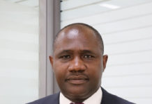 Mr. Emmanuel Odartey Lamptey as the new Deputy Managing Director (DMD) - Operations - GCB Bank Limited.