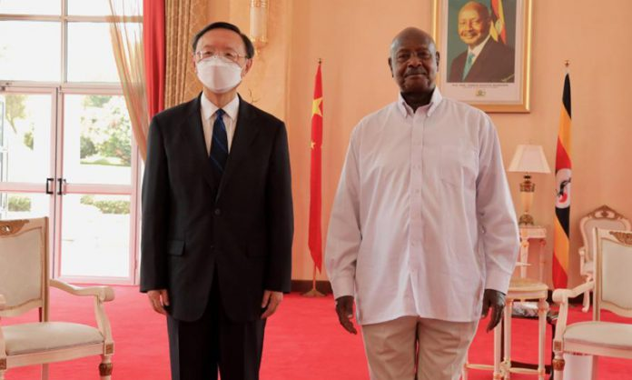 Ugandan President Yoweri Museveni (R) meets with Yang Jiechi, a member of the Political Bureau of the Communist Party of China (CPC) Central Committee and director of the Office of the Foreign Affairs Commission of the CPC Central Committee, in Entebbe, Uganda, Feb. 21, 2021. (Photo by Hajarah Nalwadda/Xinhua)