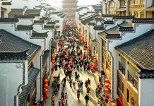 People visit an ancient town in Changxing County, Huzhou, east China's Zhejiang Province, Feb. 17, 2021. (Photo by Wu Zheng/People's Daily Online)