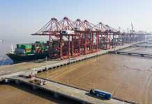Photo taken on Jan. 18 shows containers at port in East China's Zhejiang Province, Ningbo. Photo by Jiang Xiaodong/People's Daily Online