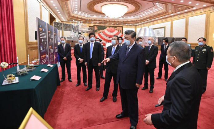 Chinese President Xi Jinping, also general secretary of the Communist Party of China (CPC) Central Committee and chairman of the Central Military Commission, visits an exhibition on the lunar samples brought back by the Chang'e-5 probe and China's lunar exploration achievements at the Great Hall of the People in Beijing, capital of China, Feb. 22, 2021. (Photo: Xinhua)