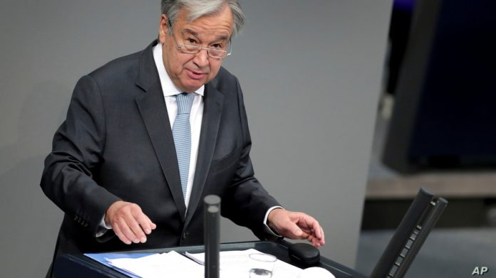 FILE - UN Secretary-General Antonio Guterres delivers a speech during a meeting of the German federal parliament, Bundestag, at the Reichstag building in Berlin, Germany, Dec. 18, 2020. (AP Photo/Michael Sohn)