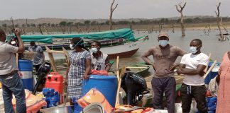 Picture shows some PAPs with working tools on the bank of the Black Volta reservoir