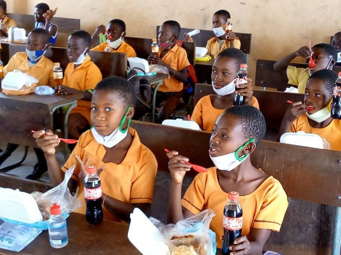 Photo showing some of the pupils eating