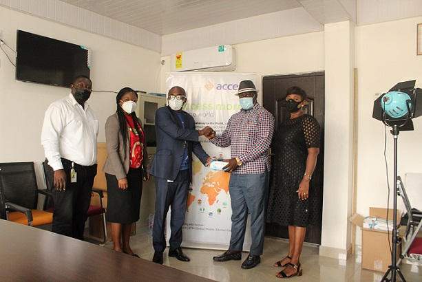 Jones Darmoe Left Presents Items To David Amoateng Right As Other Members Of Access Bank And Tagg Look On
