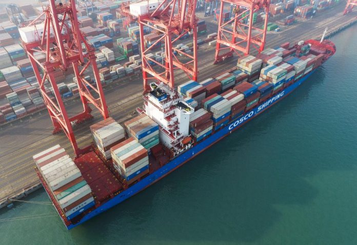 A container ship is about to leave a terminal in Lianyungang Port, east China's Jiangsu province after being loaded with containers, Jan. 14, 2021. (Photo by Wang Jianmin/People's Daily Online)