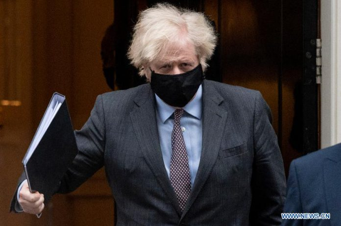 British Prime Minister Boris Johnson leaves 10 Downing Street for the House of Commons in London, Britain, on Feb. 22, 2021. Johnson announced Monday that schools in England will reopen from March 8 as part of the