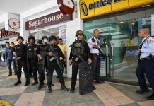 SWAT teams are attempting to negotiate with the ex-guard turned gunman / AFP via Getty Images