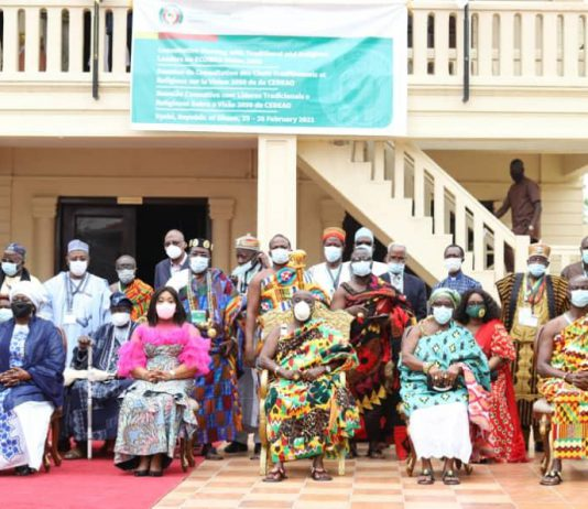 Madam Shirley Ayorkor Botchwey (seated 3rd left), Madam Finda Koroma (seated 2nd) and the Okyenhene, Osagyefuo Amoatia Ofori Payin (seated middle) in a group photograph with participants