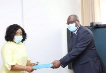 Madam Shirley Ayorkor Botchwey (left) receiving the credentials from Dr Francis Kasolo