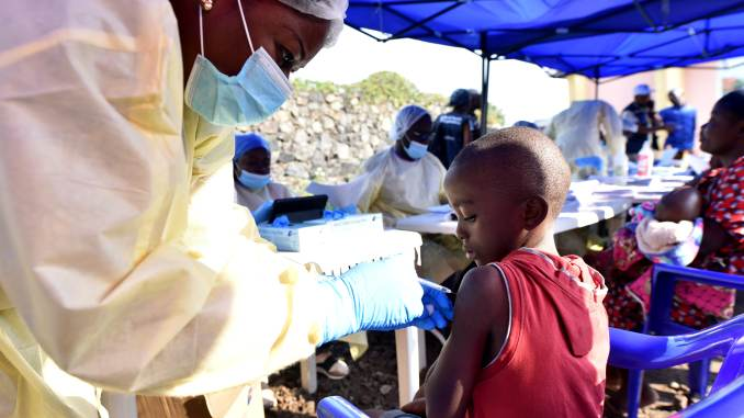 A Congolese health worker administers ebola vaccine to a child at the Himbi Health Centre in Goma, Democratic Republic of Congo, July 17, 2019. Olivia Acland | Reuters