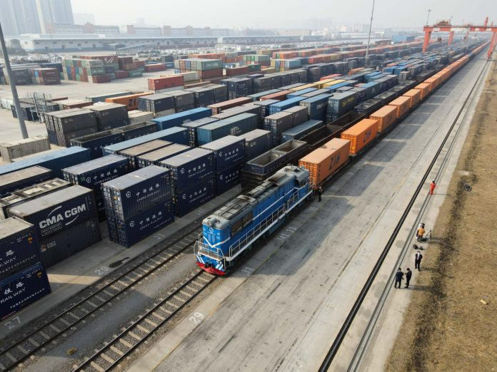 A freight train leaves Zhengzhou, central China's Henan province, for Katowice, Poland, February 10, 2021. (Photo by Li Zhangpeng/People's Daily Online)