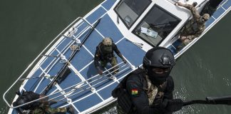 A service member with Ghanaian Special Forces ascends a ladder during a boarding exercise as part of Obangame Express 2021, March 17, 2021.