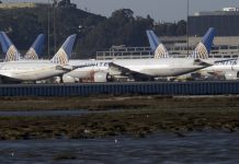 United Airlines planes sit on the tarmac at the San Francisco International Airport (SFO) in San Francisco, California, USA, 22 February 2021. Federal regulators and United Airlines recently announced they will be grounding 24 Boeing 777 aircraft powered by Pratt & Whitney 4000 series engines, the same engine used in the United Flight 328, tail number N772UA incident that experienced a right engine failure that scattered parts over a neighborhood in Colorado bound for Honolulu, Hawaii and made an emergency on its return to Denver International Airport. EPA/JOHN G. MABANGLO