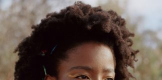 Amanda Gorman with natural hair style and jewelry