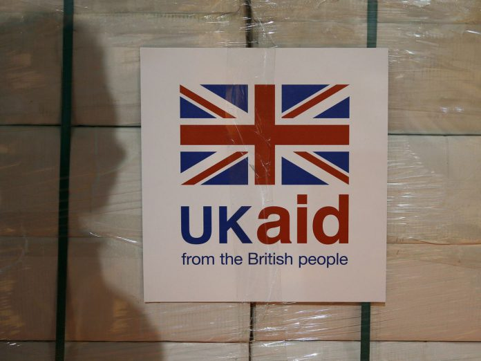 A UK Aid label is attached to a box containing kitchen sets
